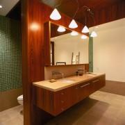 view of the bathroom featuring teak veneer vanity architecture, bathroom, cabinetry, ceiling, countertop, interior design, room, sink, wood, brown, orange