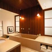 view of the bathroom featuring teak veneer vanity bathroom, ceiling, flooring, interior design, room, wood, orange, brown, red