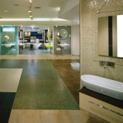 view of the bathroom showroom - view of architecture, bathroom, ceiling, floor, flooring, interior design, room, tile, wall, wood flooring, brown