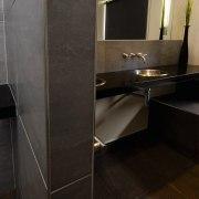 A view of a bathroom by NKBA. - bathroom, countertop, floor, flooring, interior design, plumbing fixture, room, sink, tile, black