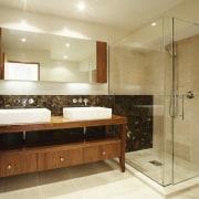 A view of a bathroom by NKBA. - bathroom, floor, interior design, real estate, room, sink, brown