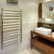 A view of a bathroom by NKBA. - bathroom, floor, flooring, interior design, room, tile, orange