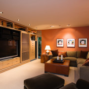 view of the family living/home theatre area featuring ceiling, home, interior design, living room, room, wall, brown, orange