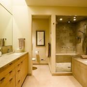 view of the master bathroom featuring limetsone surfaces, bathroom, estate, home, interior design, room, suite, brown, orange