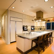view of the kitchen  featuring stainless steel cabinetry, ceiling, countertop, cuisine classique, flooring, hardwood, home, interior design, kitchen, real estate, room, wood flooring, orange, brown