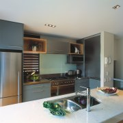 A view of a kitchen with Haier Appliances cabinetry, countertop, home appliance, interior design, kitchen, room, gray