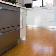 View of stainless steel dishdrawer dishwasher. - View cabinetry, chest of drawers, drawer, floor, flooring, furniture, hardwood, home, laminate flooring, property, room, wall, wood, wood flooring, wood stain, white, brown