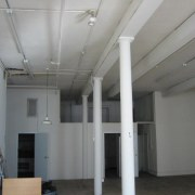 A view of the living area before it ceiling, daylighting, floor, real estate, roof, structure, gray