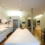 A view of the kitchen, wooden flooring, white architecture, ceiling, interior design, real estate, room, table, gray