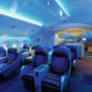 A view of the cabin area. - A aerospace engineering, air travel, aircraft, aircraft cabin, airline, airplane, aviation, blue, interior design, mode of transport, passenger, blue, teal