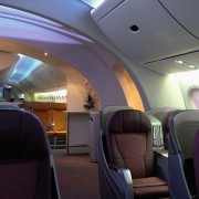 A view of the cabin area. - A air travel, aircraft, aircraft cabin, airline, airplane, aviation, interior design, passenger, black, gray