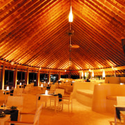 A viewof the restaurant. - A viewof the ceiling, function hall, interior design, lighting, night, restaurant, wood, red