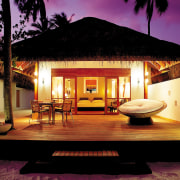 A viewof a deluxe beach bungalow. - A estate, home, house, lighting, property, real estate, resort, villa, black