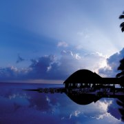 An exterior view of bungalow. - An exterior afterglow, atmosphere, calm, cloud, computer wallpaper, dawn, daytime, dusk, evening, horizon, morning, nature, ocean, phenomenon, reflection, sea, sky, sunrise, sunset, tree, tropics, water, blue