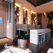 view of the bar and seating areas featuring furniture, interior design, lobby, restaurant, table, black