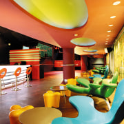 view of the interior of the zouk nightclub interior design, restaurant, yellow, orange