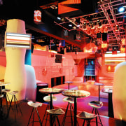 view of the dancefloor featuring end grain wood design, interior design, lighting, restaurant, stage, table, black, red
