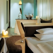 view of the guest room featuring resin headboard/desk/nighttable, furniture, interior design, room, suite, table