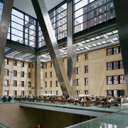 view of the builinding atrium featuring a sculptural apartment, architecture, building, condominium, daylighting, metropolitan area, mixed use, window, gray, black
