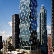 view of the exterior of this hi-rise building architecture, building, city, cityscape, commercial building, condominium, corporate headquarters, daytime, downtown, facade, headquarters, landmark, metropolis, metropolitan area, mixed use, sky, skyline, skyscraper, tower, tower block, urban area, black, teal