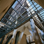 view of the builinding atrium featuring a sculptural architecture, beam, building, ceiling, daylighting, facade, roof, structure, tourist attraction, wood, brown