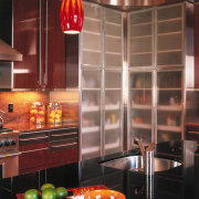 A view of the kitchen, wooden and glass cabinetry, ceiling, countertop, interior design, kitchen, light fixture, lighting, orange, room, under cabinet lighting, red, brown