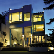 view of the exterior of this modern house apartment, architecture, building, commercial building, condominium, elevation, facade, home, house, lighting, mixed use, property, real estate, residential area, window, blue, black