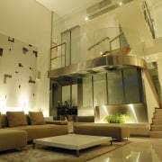 view of the interior of this house featuring ceiling, daylighting, furniture, interior design, lighting, living room, lobby, room, table, brown, orange