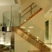 view of the interior of this house featuring architecture, ceiling, daylighting, glass, handrail, interior design, lobby, stairs, brown, orange