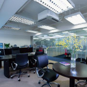 A view of a office. - A view ceiling, conference hall, interior design, office, gray