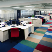 A view of the office, carpet. lights, workstations. furniture, interior design, office, gray
