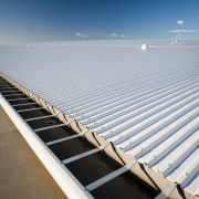 A view of the Dimond roofing. - A daylighting, energy, fixed link, line, roof, sea, sky, structure, sunlight, water, gray