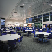 A view of the staff cafeteria. - A institution, interior design, restaurant, gray, black