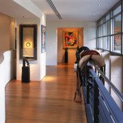 view of the artwork featuring various artworks and apartment, floor, flooring, interior design, real estate, brown