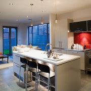 A view of some kitchen cabinetry by TM countertop, interior design, kitchen, real estate, room, gray