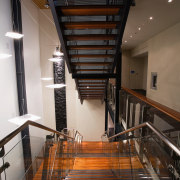 A view of the Trends Building. - A apartment, architecture, ceiling, daylighting, handrail, interior design, stairs, wood, black, brown