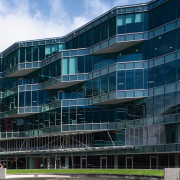 An exterior view of the Microsoft building. - apartment, architecture, building, commercial building, condominium, corporate headquarters, daytime, facade, headquarters, metropolis, metropolitan area, mixed use, residential area, sky, blue, black