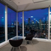 A view of the Microsoft headquarters. - A apartment, architecture, condominium, glass, interior design, real estate, sky, window, black, blue, gray