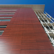 An exterior view of the cedar cladding. - architecture, brick, brickwork, building, commercial building, corporate headquarters, daylighting, daytime, facade, landmark, line, roof, siding, sky, structure, wall, wood, red