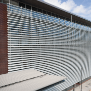 A view of the louvres. - A view architecture, building, commercial building, corporate headquarters, daylighting, facade, headquarters, house, line, metropolitan area, real estate, residential area, roof, siding, structure, window, window covering, gray, black, white