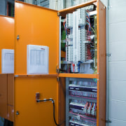 A viewof the electrical technology. - A viewof electrical wiring, machine, product, shelving