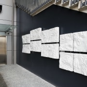 A view of some artwork. - A view architecture, exhibition, floor, product design, wall, black, white
