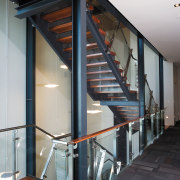 A view of the stairway. - A view architecture, daylighting, glass, handrail, house, stairs, structure, black, gray
