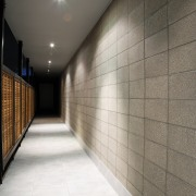 A view of the hallway. - A view architecture, ceiling, daylighting, floor, flooring, interior design, light, lighting, lobby, tile, wall, wood, gray