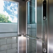 A view of a lift from Kone Elevators. glass, gray, black