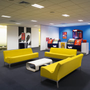 view of this breakout area featuring yellow couches, institution, interior design, office, product, product design, black