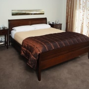 A view of some furniture from Nobelwood. - bed, bed frame, bed sheet, bedroom, floor, flooring, furniture, hardwood, mattress, room, wood, black, white