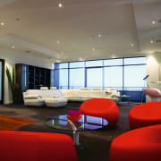 Large open plan apartment showing red chair seating architecture, ceiling, conference hall, interior design, lobby, real estate, room, gray