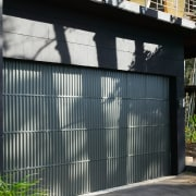 view of the corrugated iron garage doors  architecture, building, door, facade, garage, garage door, house, shed, siding, window, black