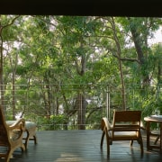 view from the ouitdoor balcony looking out into furniture, home, house, interior design, living room, outdoor furniture, outdoor structure, plant, table, tree, window, wood, brown